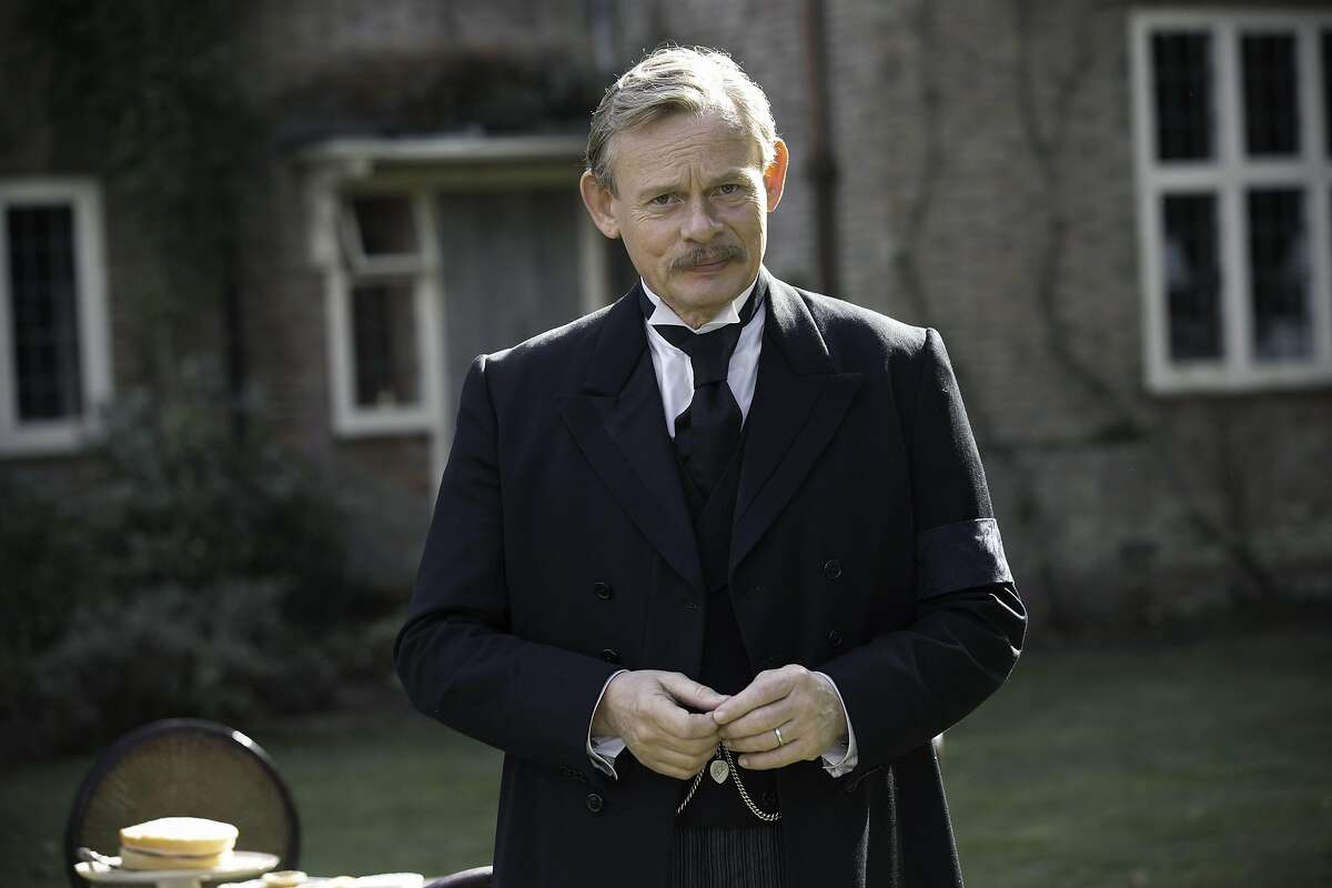 """Martin Clunes as Sir Arthur Conan Doyle in thre-part mystery, 'Arthur & George,' on PBS. September, 2015 MASTERPIECE Arthur & George Sundays, September 6 â€"""" 20, 2015 at 8pm ET Martin Clunes (Doc Martin) stars as Sir Arthur Conan Doyle, creator of Sherlock Holmes, in a three-part MASTERPIECE Mystery! adaptation of a novel by Julian Barnes based on an actual event. Outraged by injustice to an Anglo-Indian solicitor, Doyle uses the methods of his own fictional detective to get at the truth. Also starring are Arsher Ali (The Missing), Charles Edwards (Downton Abbey), Hattie Morahan (The Bletchley Circle), and Art Malik (The Jewel in the Crown). Arthur & George airs on MASTERPIECE at the special time of 8pm ET on PBS. Shown: Martin Clunes as Sir Arthur Conan Doyle (C) Neil Genower/Buffalo Pictures and MASTERPIECE for ITV and MASTERPIECE This image may be used only in the direct promotion of MASTERPIECE. No other rights are granted. All rights are reserved. Editorial use only."""