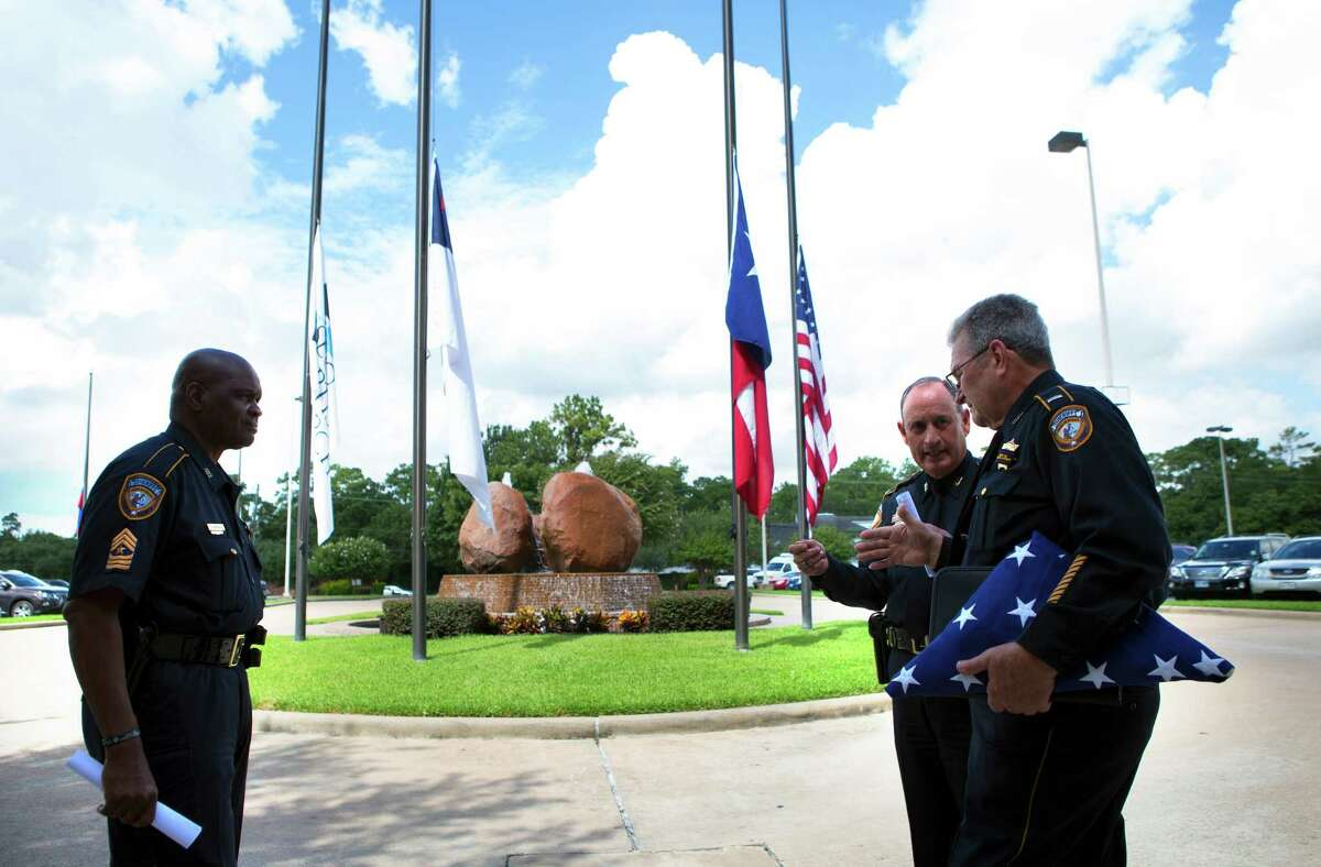 Authorities prepare for the funeral of Harris County Sheriff's Deputy Darren Goforth, Thursday, Sept. 3, 2015, in Houston. Goforth was killed Friday in an apparent ambush shooting while he pumped gas. Shannon Miles, the man accused in the shooting, reportedly had spent an unknown amount of time under psychiatric care prior to the shooting.