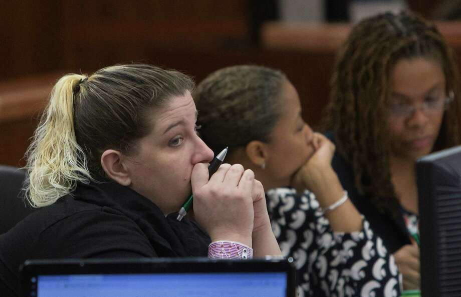 Kelly Jo Ivey sits with her attorneys during her trial in the 208th State District Court at the Harris County Criminal Courthouse, Thursday, Sept. 3, 2015, in Houston. Ivey crashed into Harris County Sheriff's Office deputy Jesse Valdez, killing him, in 2014. Photo: Cody Duty, Houston Chronicle / © 2015 Houston Chronicle