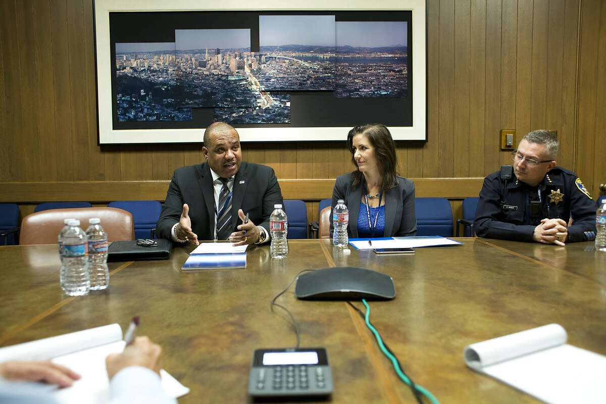 Oakland Mayor Libby Schaaf, center, and Oakland Chief of Police Sean Whent listen as Ron Davis, far left, executive director of President Obama?•s Task Force on 21st Century Policing, makes a point during an editorial board meeting at the Chronicle on September 3, 2015 in San Francisco, Calif.