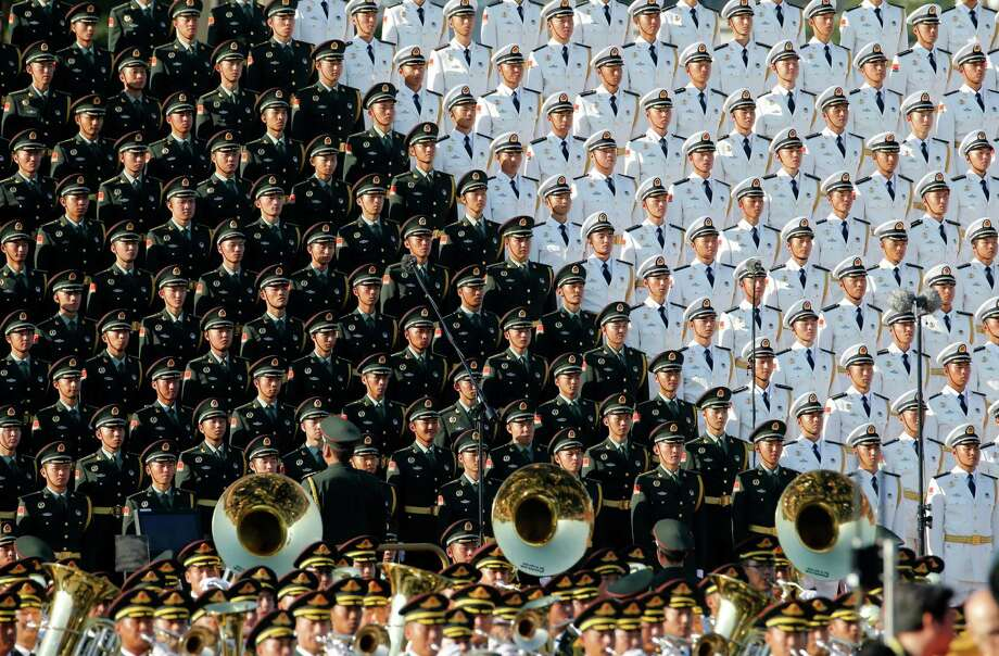 A military band performs before a parade commemorating the 70th anniversary of Japan's surrender during World War II held Thursday in Beijing. Photo: Ng Han Guan, STF / AP