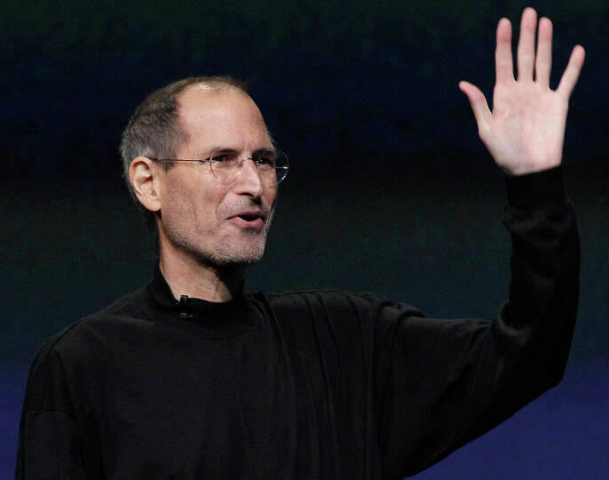FILE - In this March 2, 2011 file photo, Apple Inc. Chairman and CEO Steve Jobs waves to his audienc