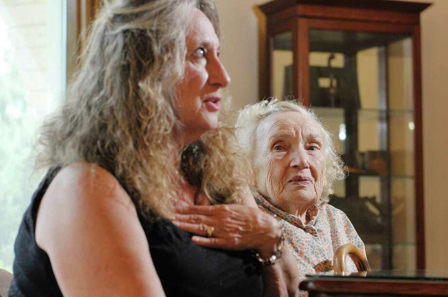 Artist Maria Kolodziej-Zincio, left, and her mother Regina Borysiewicz are interviewed at the St. Agnes Cemetery gallery on Wednesday, Aug. 26, 2015 in Menands, N.Y.  Zincio has created artwork which is based on her mother's experiences as a Holocaust survivor. (Paul Buckowski / Times Union) Photo: PAUL BUCKOWSKI / 00033137A