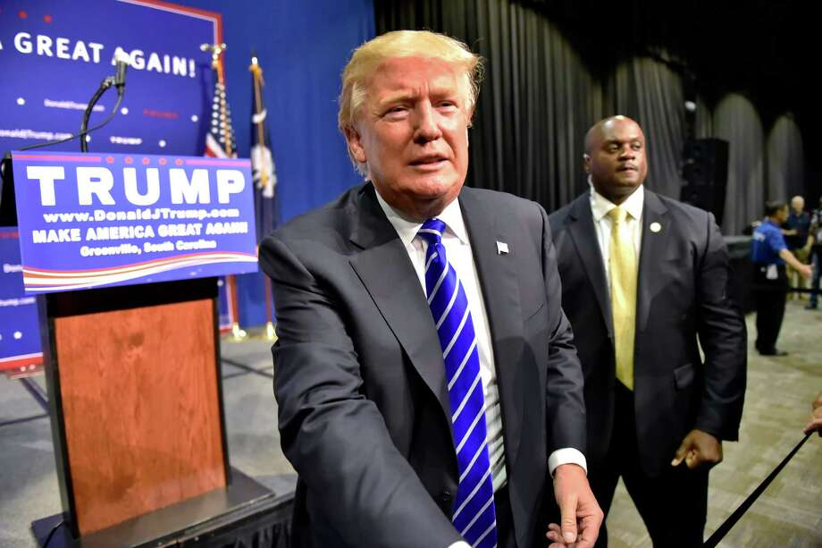 "FILE - In this Aug. 27, 2015 file photo, Republican presidential candidate Donald Trump greets supporters after speaking at a rally at the TD Convention Center in Greenville, S.C. NBC announced Tuesday, Sept. 1, that Trump will sit down with host Jimmy Fallon to discuss his campaign and other issues on ""The Tonight Show Starring Jimmy Fallon,"" on Sept. 11. (AP Photo/Richard Shiro, File) ORG XMIT: NYET201 Photo: RICHARD SHIRO / FR159523 AP"