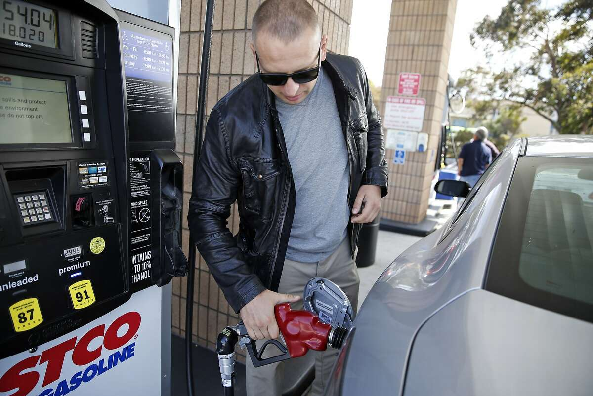 Vlad Koroloff fills up his tank with gasoline at Costco in South San Francisco, Calif., on Thursday, September 3, 2015.