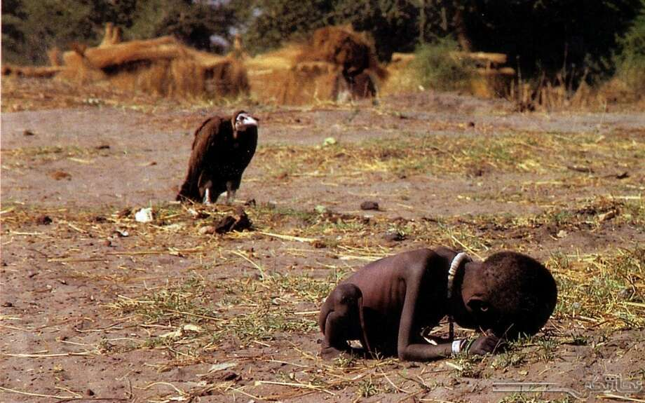 SOUTH SUDAN   South African photojournalist Kevin Carter took this image in 1993 in Southern Sudan of a starving girl with a vulture lurking in the background. The image received the Pulitzer Prize for Feature Photography in April 1994. Carter committed suicide later that year. Photo: Kevin Carter
