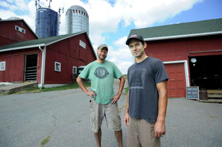 Adam Mantzaris, left, and John Motsinger are the farm managers at town-owned Happy Acres Fram in Sherman. They and other farmers are seeking more flexibility in town rules on farm-based sales. Photo: Carol Kaliff / Hearst Connecticut Media / The News-Times