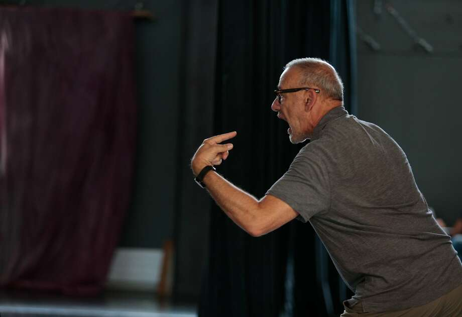 """Joe Goode demonstrates a move to his dancers during a rehearsal for """"The Poetics of Space."""" Photo: Nathaniel Y. Downes, The Chronicle"""