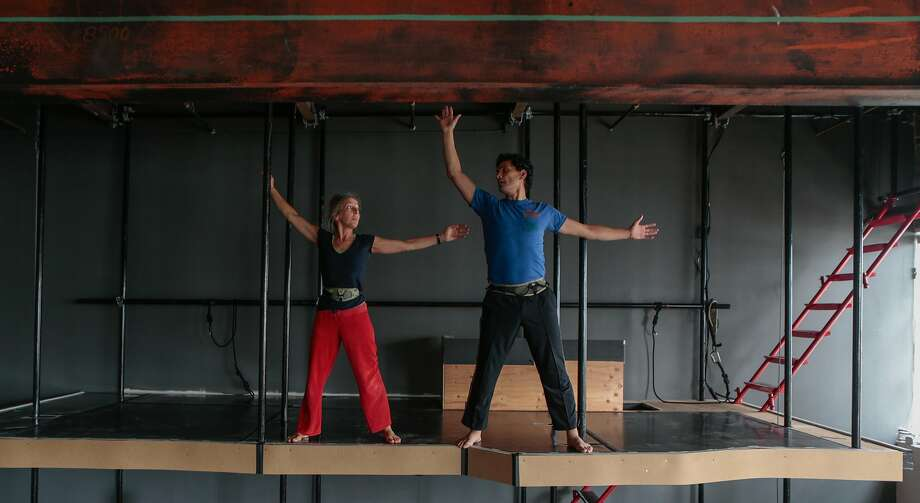 """From left, Marit Brook-Kothlow and Felipe Barrueto-Cabello rehearse a scene from Joe Goode's latest work, """"Poetics of Space"""", a blend of drama and choreography in installations which viewers walk through on Wednesday, Sept. 2, 2015 in San Francisco, Calif. Goode celebrates 30 years working in dance theater this year. Photo: Nathaniel Y. Downes, The Chronicle"""