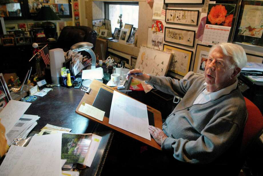 "Mort Walker works on a ""Beetle Bailey"" strip in his studio at his home in Stamford in 2012. The strip turns 65 Friday, Sept. 4, 2015. Walker celebrated his 92nd birthday Thursday. Photo: Staff File Photo / Stamford Advocate Freelance"
