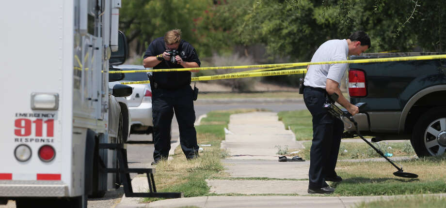 In this photo taken Friday, Aug. 28, 2015, the Bexar County Sheriff's Department investigates the scene where deputies shot a man as they responded to a domestic disturbance call in Northwest Bexar County, Texas, near San Antonio. Gilbert Flores, 41, who was taken to a hospital, died shortly after the shooting Friday, the Bexar County Sheriff's Office said in a statement Monday, Aug. 31, 2015. Video obtained by KSAT-TV, that was taken by a bystander, appears to show Flores standing still with his arms raised just before two shots are heard. The deputies are on administrative leave. (John Davenport/The San Antonio Express-News via AP) RUMBO DE SAN ANTONIO OUT; NO SALES; MANDATORY CREDIT   MBO Photo: John Davenport, MBO / Associated Press / The San Antonio Express-News