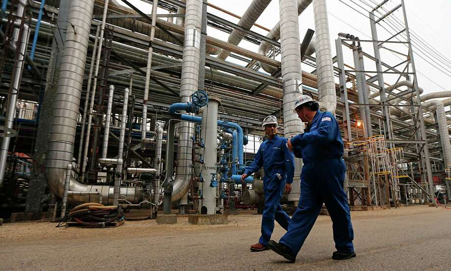 """LyondellBasell CEO Bhavesh """"Bob"""" Patel, left, and plant manager Todd Monette pass through the olefins plant in Channelview. Photo: James Nielsen, Staff / © 2015  Houston Chronicle"""