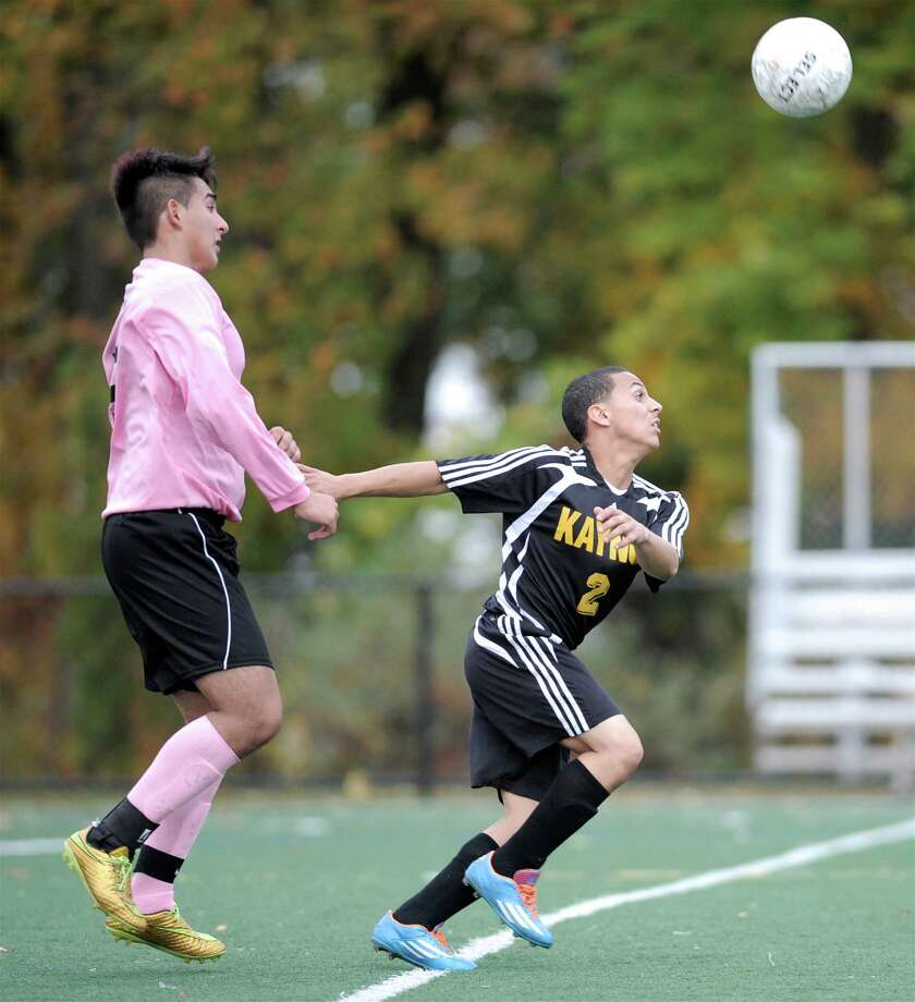 Kaynor Tech's Rubin Martinez (2), right, chases the ball ahead of Abbott Tech's Kevin Guzman (5) during the boys high school soccer game between Kaynor Tech and Abbott Tech High School, played at Broadview Middle School, Danbury, Conn, on Wednesday, October 15, 2014. Photo: H John Voorhees III / H John Voorhees III / The News-Times Staff Photographer