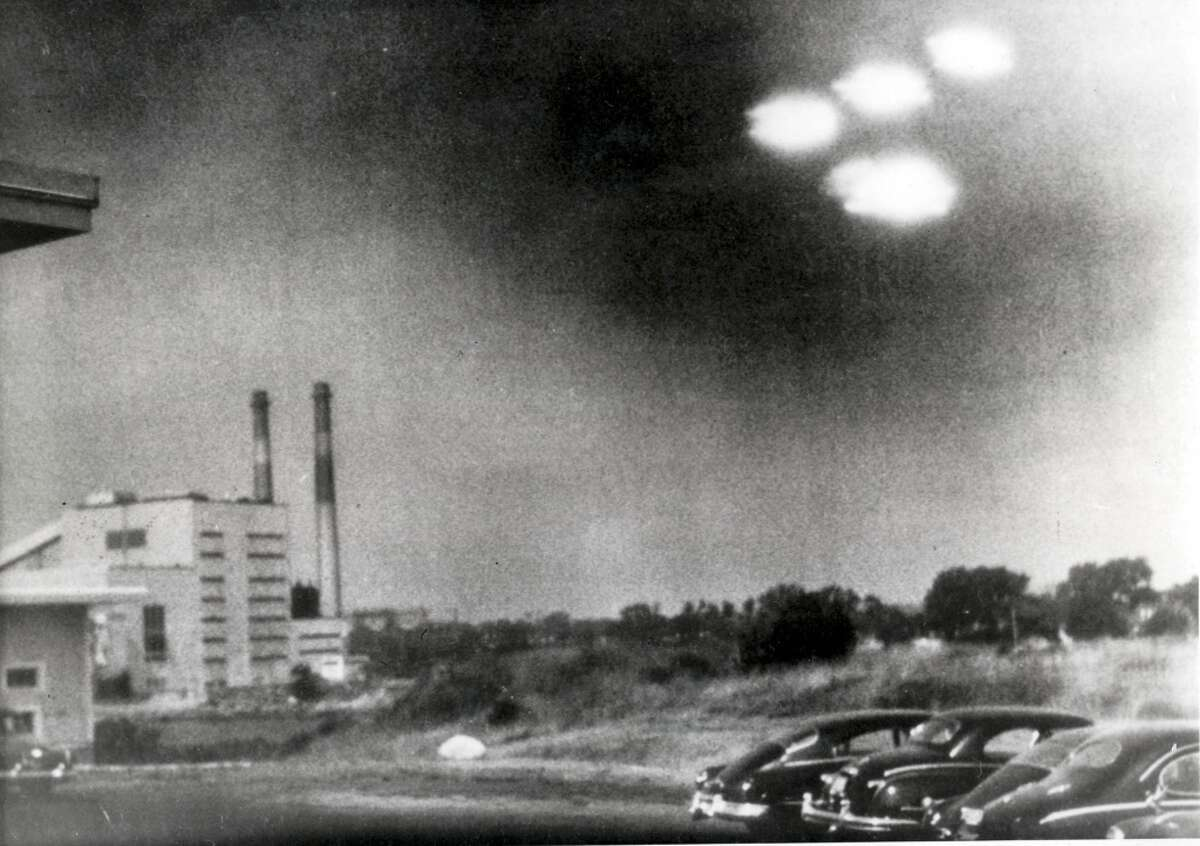 Salem, Massachusetts, USA, 3rd August, 1952, This picture, taken through the window of a laboratory by a 21 year old U,S, coastguard, shows four unidentified flying objects as bright lights in the sky, Many American's believe them to be flying saucers (Photo by Popperfoto/Getty Images)