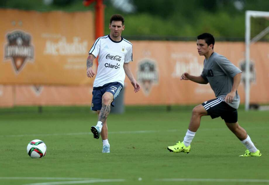 The Dynamo's under-17 players had the thrill of a lifetime when they worked out with four-time FIFA Player of the Year Lionel Messi, center, Tuesday. Photo: Gary Coronado, Staff / © 2015 Houston Chronicle