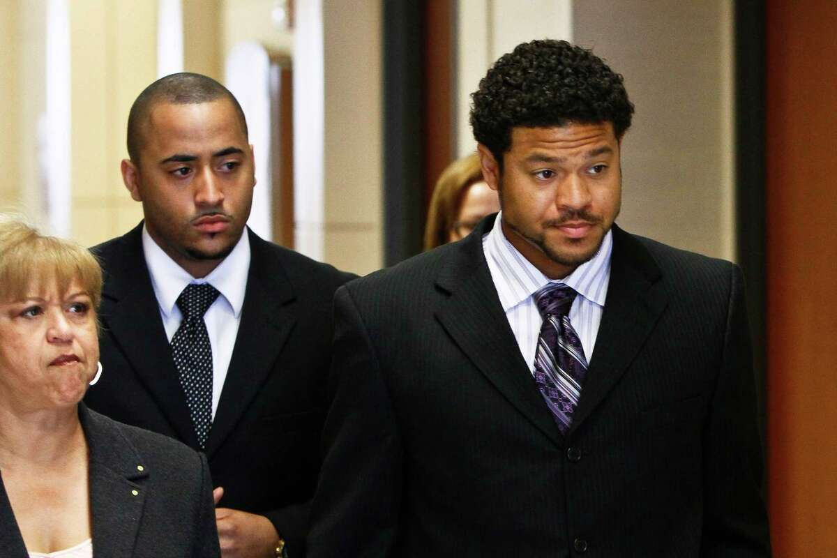 """Robert Tolan (right) walks into the courtroom during a court hearing for the aggravated assault trial against Bellaire Police Sgt. Jeff Cotton who is accused of shooting Robert Tolan in his parents' driveway last year, Thursday, May 6, 2010, in Houston. Cotton, 40, is charged with aggravated assault by a public servant. His attorney said the 10-year veteran officer is looking forward to having all of the evidence about the shooting come out. """"Sgt. Cotton acted as a reasonable police officer would have acted under the circumstances,"""" lawyer Paul Aman said. The shooting sparked complaints of racial profiling against Cotton and the Bellaire Police Department. Cotton is white, Tolan is black. Cotton has denied Tolan's race affected his actions, and his lawyer said the officer fired when he thought his life was in danger. ( Michael Paulsen / Houston Chronicle )"""