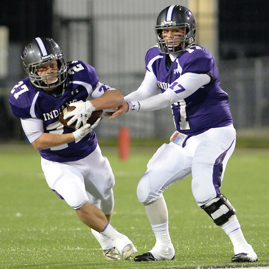 Port Neches-Groves' Adam Morse hands off the ball to running back Brant Halfin as they face Dayton during their playoff game Saturday at Stallworth Stadium.  Photo taken Saturday, November 15, 2014 Kim Brent/The Enterprise Photo: KIM BRENT / Beaumont Enterprise