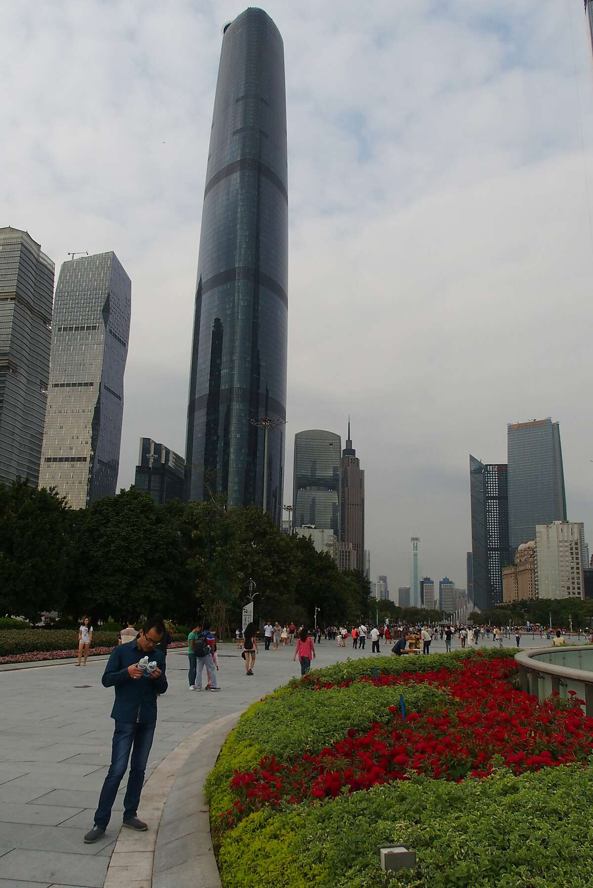 The centerpiece to Guangzhou's central business district, known as Zhujiang New Town, is a sprawling pedestrian plaza with an underground mall, parks, wildly creative public buildings and assorted skyscrapers.