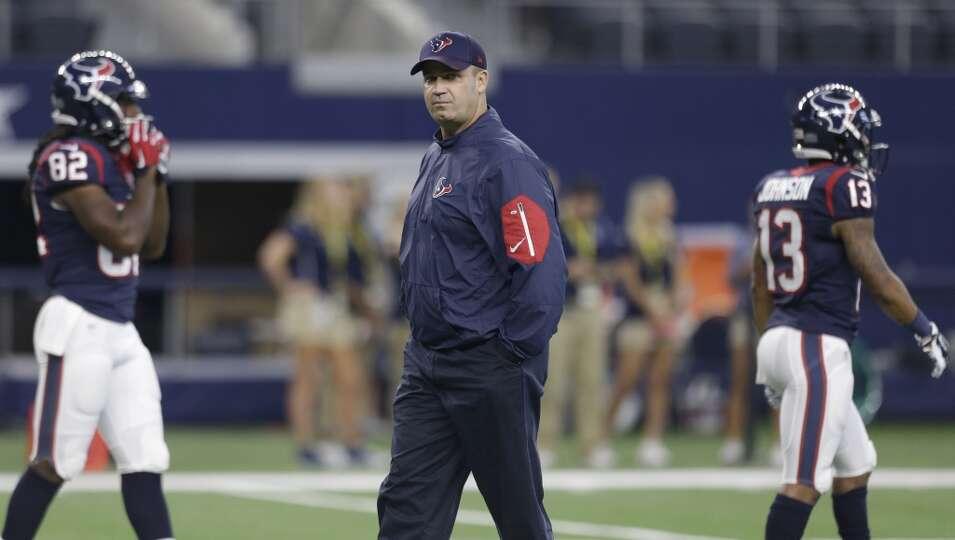 Houston Texans head coach Bill O'Brien walks on the field before an NFL pre-season football game aga