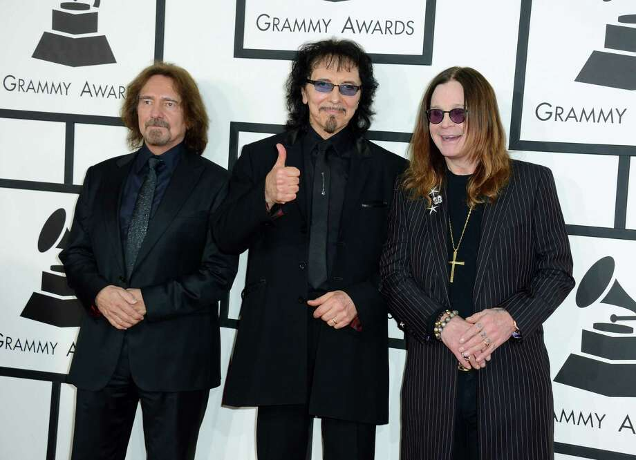 FILE - In this Jan. 26, 2014 file photo, Geezer Butler, from left, Tony Iommi and Ozzy Osbourne of Black Sabbath arrive at the 56th annual Grammy Awards in Los Angeles. Black Sabbath will launch a farewell tour next year. The heavy metal band starring Ozzy Osbourne announced dates for its The End tour, which kicks off Jan. 20, 2016, in Omaha, Nebraska. (Photo by Jordan Strauss/Invision/AP, File) ORG XMIT: NYET420 Photo: Jordan Strauss / Invision