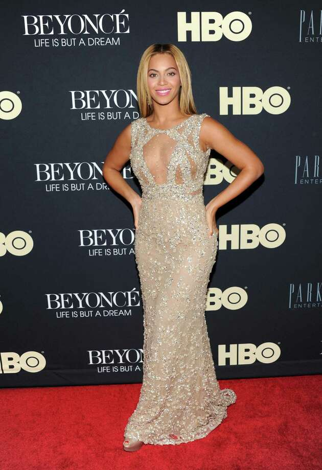 """FILE - In this Feb. 12, 2013 photo, Beyonce Knowles attends the premiere of """"Beyonce: Life Is But A Dream"""" at the Ziegfeld Theatre, in New York. Knowles is among 11 celebrities and government officials whose private financial information appears to have been posted online by a site that began garnering attention on Monday, March 11, 2013. (Photo by Evan Agostini/Invision/AP, File) Photo: Evan Agostini / Invision"""