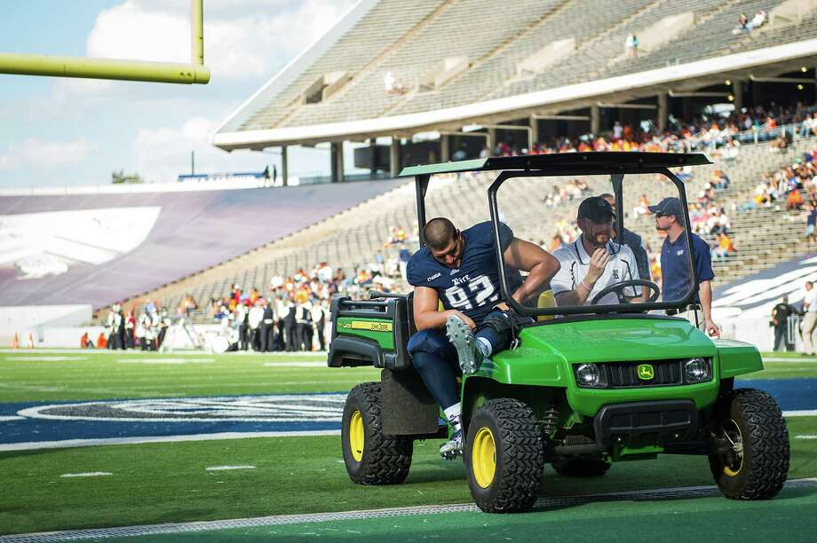 Rice defensive tackle Stuart Mouchantaf leaves a 2013 game with one of two ACL injuries that have kept him out of action until this weekend. Photo: Smiley N. Pool, Staff / © 2013  Houston Chronicle
