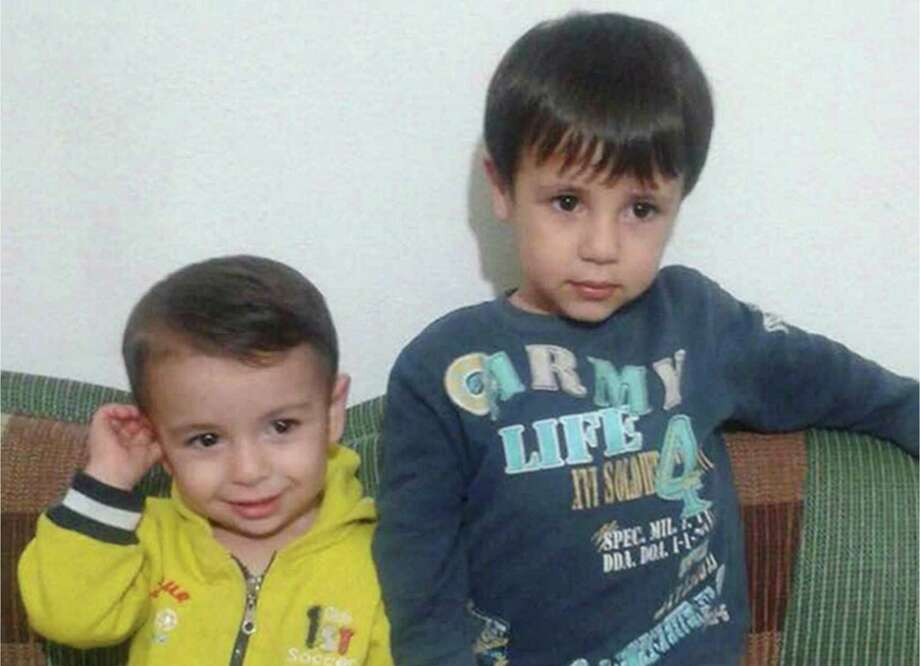 This handout photo courtesy of Tima Kurdi shows Alan Kurdi, left, and his brother Galib Kurdi. The body of 3-year-old Syrian Alan Kurdi was found on a Turkish beach after the small rubber boat he, his 5-year old brother Galib and their mother, Rehan, were in capsized during a desperate voyage from Turkey to Greece. The family stated that the spelling of the boys' names had been changed by Turkish authorities to Aylan and Galip, but were in fact spelled as Alan and Galib.  (Photo courtesy of Tima Kurdi /The Canadian Press via AP) MANDATORY CREDIT  ORG XMIT: VCRD109 / Photo courtesy of Tima Kurdi /The Canadian Press