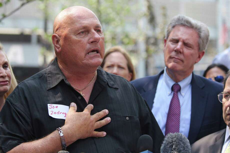 Detective James Zadroga's father Joe Zadroga, left, speaks during a news conference, Thursday, Sept. 3, 2015, in New York. Lawmakers called on Congress to prevent expiration of the James Zadroga Sept. 11 Health and Compensation Act(AP Photo/Mary Altaffer) ORG XMIT: NYMA104 Photo: Mary Altaffer / AP