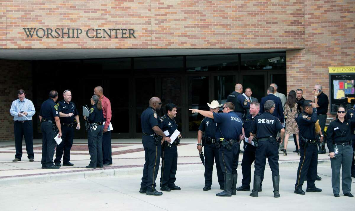 Authorities prepare Thursday for the funeral of Harris County Sheriff's Deputy Darren Goforth at Second Baptist Church.