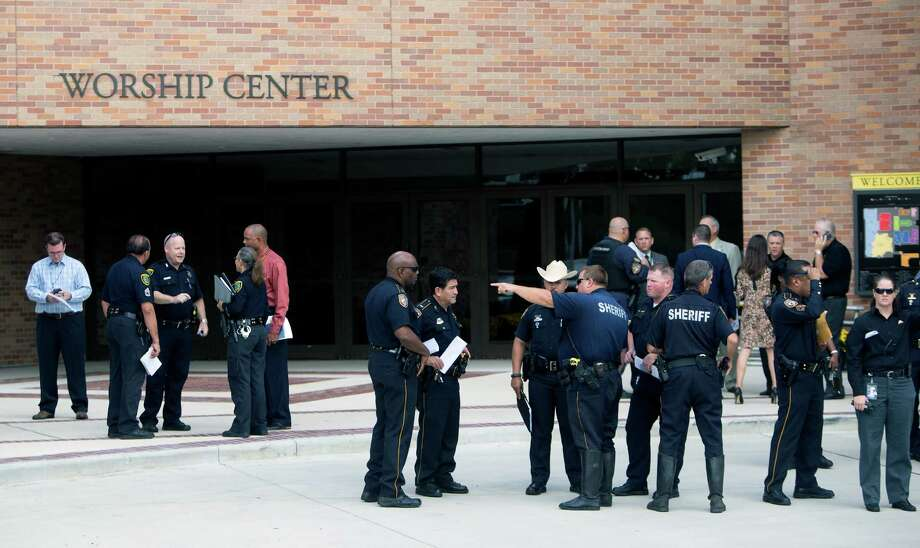 Authorities prepare Thursday for the funeral of Harris County Sheriff's Deputy Darren Goforth at Second Baptist Church. Photo: Cody Duty, Staff / © 2015 Houston Chronicle