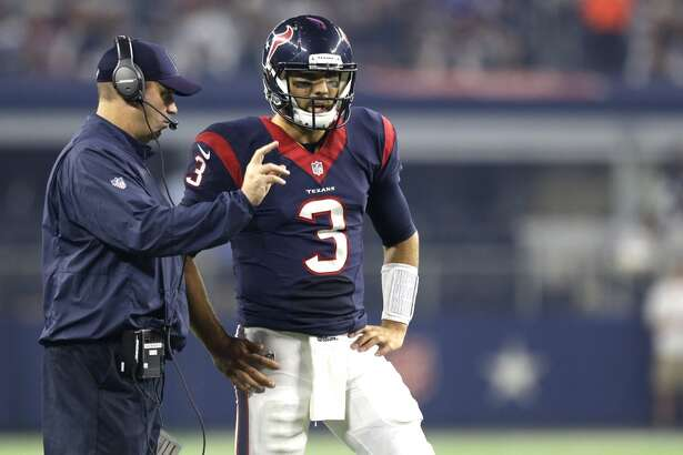 Houston Texans head coach Bill O'Brien talks to quarterback Tom Savage (3) during a time out against the Dallas Cowboys during the second quarter of an NFL pre-season football game at AT&T Stadium on Thursday, Sept. 3, 2015, in Arlington. ( Brett Coomer / Houston Chronicle )