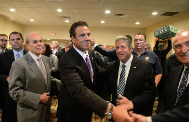 Gov. Andrew Cuomo meets with members of the New York City Patrolmen's Benevolent Association, where he spoke during their annual convention Thursday, Aug. 3, 2015, at the Holiday Inn in Colonie, N.Y. Patrick Lynch president of the New York City PBA, stands next to Gov. Cuomo, right. Gov. Cuomo was awarded with the association's Man of the Year award. (Will Waldron/Times Union) Photo: Will Waldron / 00033226A