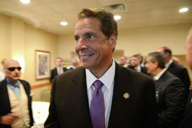 Gov. Andrew Cuomo meets with members of the New York City Patrolmen's Benevolent Association, where he spoke during their annual convention Thursday, Aug. 3, 2015, at the Holiday Inn in Colonie, N.Y. Gov. Cuomo was awarded with the association's Man of the Year award. (Will Waldron/Times Union) Photo: Will Waldron / 00033226A