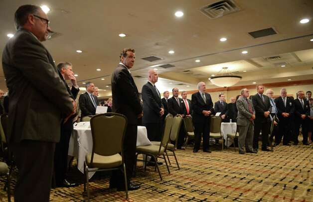 Gov. Andrew Cuomo listens to the opening invocation during the New York City Patrolmen's Benevolent Association annual convention Thursday, Aug. 3, 2015, at the Holiday Inn in Colonie, N.Y. Gov. Cuomo was awarded with the association's Man of the Year award. (Will Waldron/Times Union) Photo: Will Waldron / 00033226A