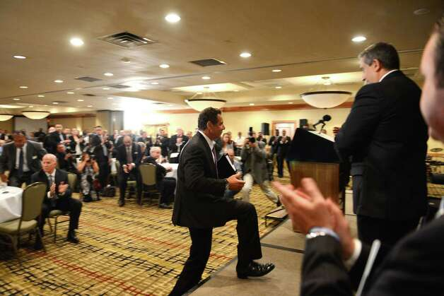 Gov. Andrew Cuomo ascends the stage before speaking during the New York City Patrolmen's Benevolent Association annual convention Thursday, Aug. 3, 2015, at the Holiday Inn in Colonie, N.Y. Gov. Cuomo was awarded with the association's Man of the Year award. (Will Waldron/Times Union) Photo: Will Waldron / 00033226A
