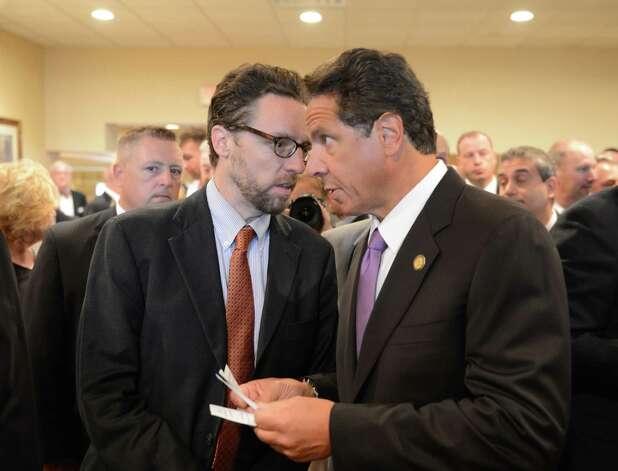 Gov. Andrew Cuomo, right, listens to his spokesman John Kelly, left, before addressing the New York City Patrolmen's Benevolent Association's annual convention Thursday, Aug. 3, 2015, at the Holiday Inn in Colonie, N.Y. Gov. Cuomo was awarded with the association's Man of the Year award. (Will Waldron/Times Union) Photo: Will Waldron / 00033226A