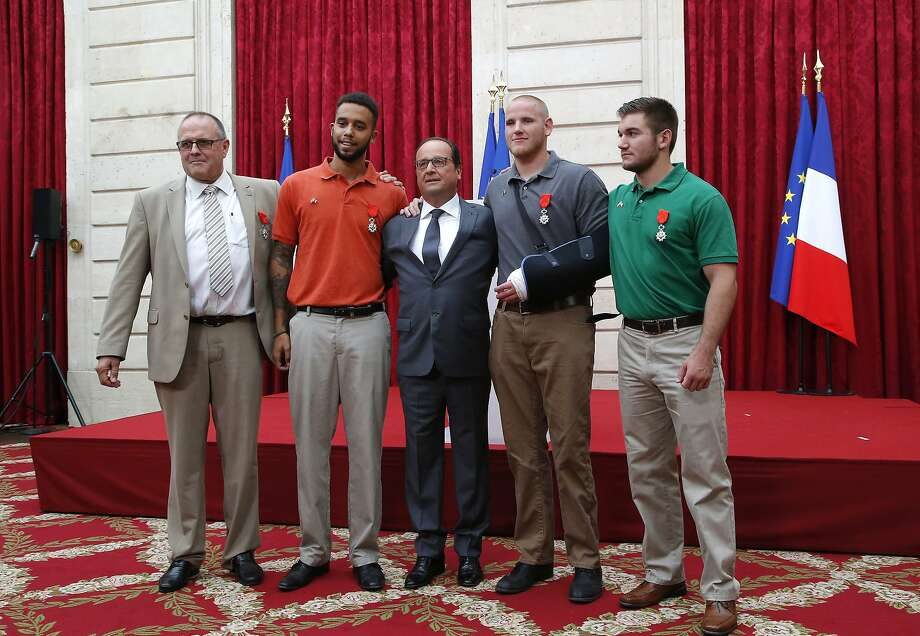 French President Francois Hollande, center, with the three Americans and a Briton who were awarded a Legion of Honor for disarming an attacker aboard a high-speed train, during a ceremony at the Elysee Palace in Paris, Aug. 24, 2015. From left: British consultant Chris Norman, Anthony Sadler, Hollande, Airman First Class Spencer Stone and Oregon National Guard Spc. Alek Skarlatos. The polo shirt has been linked with all kinds of iconography and stereotypes over the years. But as of Monday, it had another association that may trump them all: hero. Photo: Michel Euler, New York Times