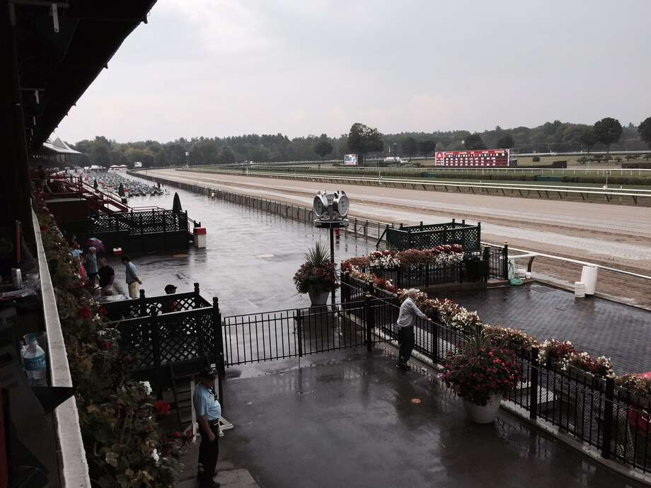 Yes, there was racing at Saratoga on Thursday, but you would never know it by looking out at the track apron right after the featured P.G. Johnson was run. A steady rain began to fall right before the fourth race and it stuck around for awhile. The track fans, who would normally flock to the apron to get a good spot to watch the horses, were hunkered down inside, waiting for the wet stuff to disappear. —Tim Wilkin