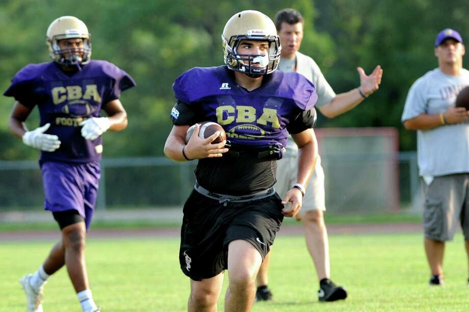 CBA's Dom Herald, center, carries the ball during football practice on Thursday, Sept. 3, 2015, at Christian Brothers Academy in Colonie, N.Y. CBA is preparing for their game against Shaker on Friday night. (Cindy Schultz / Times Union) Photo: Cindy Schultz / 00033229A