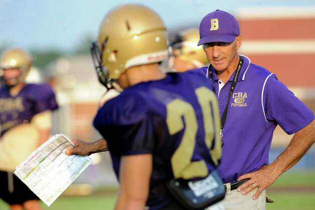 CBA head coach Joe Burke, right, works with his team during football practice on Thursday, Sept. 3, 2015, at Christian Brothers Academy in Colonie, N.Y. CBA is preparing for their game against Shaker on Friday night. (Cindy Schultz / Times Union) Photo: Cindy Schultz / 00033229A