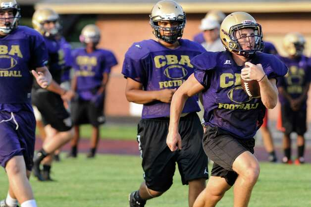 CBA runs a play during football practice on Thursday, Sept. 3, 2015, at Christian Brothers Academy in Colonie, N.Y. CBA is preparing for their game against Shaker on Friday night. (Cindy Schultz / Times Union) Photo: Cindy Schultz / 00033229A