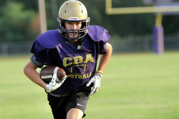 CBA's Kevin Mullady carries the ball during football practice on Thursday, Sept. 3, 2015, at Christian Brothers Academy in Colonie, N.Y. CBA is preparing for their game against Shaker on Friday night. (Cindy Schultz / Times Union) Photo: Cindy Schultz / 00033229A