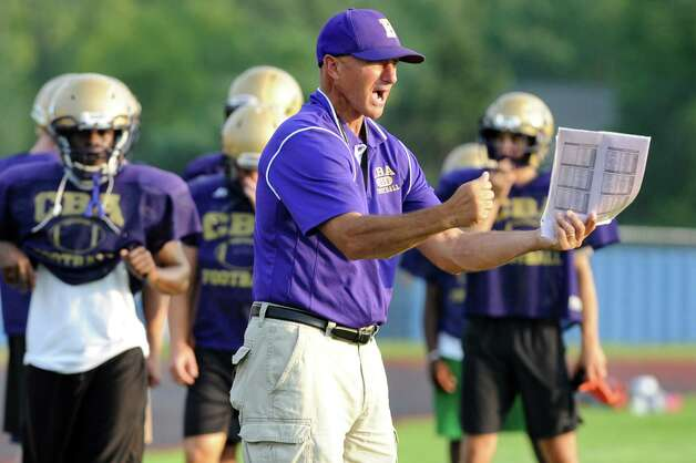 CBA's head coach Joe Burke, center, works with his team during football practice on Thursday, Sept. 3, 2015, at Christian Brothers Academy in Colonie, N.Y. CBA is preparing for their game against Shaker on Friday night. (Cindy Schultz / Times Union) Photo: Cindy Schultz / 00033229A