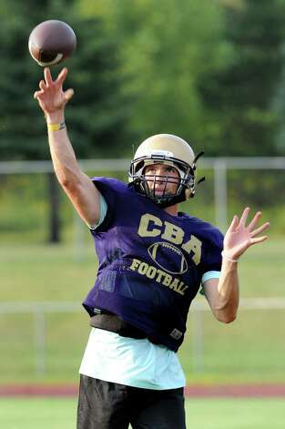 CBA's quarterback Joe Kolbe warms up his arm during football practice on Thursday, Sept. 3, 2015, at Christian Brothers Academy in Colonie, N.Y. CBA is preparing for their game against Shaker on Friday night. (Cindy Schultz / Times Union) Photo: Cindy Schultz / 00033229A