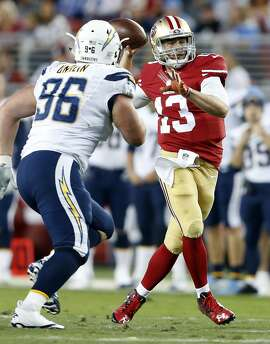 San Francisco 49ers' Dylan Thompson passes in 1st quarter against San Diego Chargers' Mitch Unrein during NFL preseason game at Levi's Stadium in Santa Clara, Calif., on Thursday, September 3, 2015.