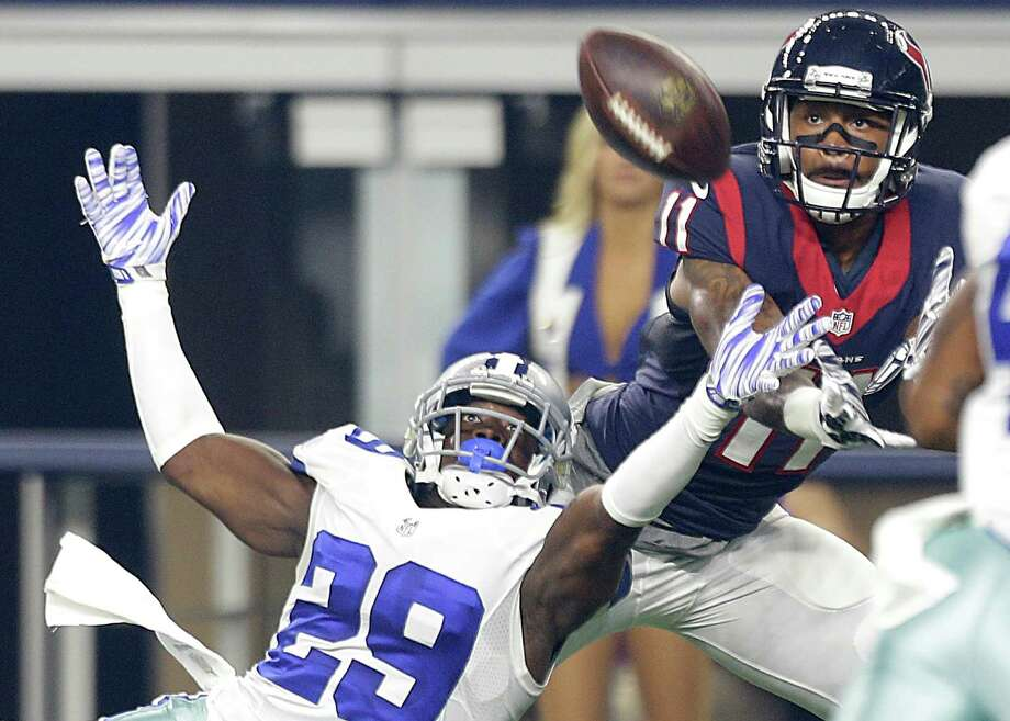 Cowboys cornerback Joel Ross (29) defends a pass to Texans wide receiver Jaelen Strong (11) during the second quarter Thursday. Photo: Brett Coomer, Staff / © 2015  Houston Chronicle