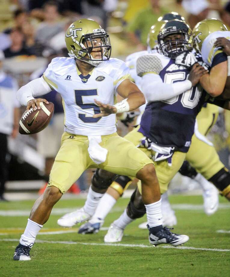 Georgia Tech quarterback Justin Thomas (5) drops back to pass as Alcorn State defensive end Ramonte Bell (50) defends during the first half of an NCAA college football game, Thursday, Sept. 3, 2015, in Atlanta. (AP Photo/John Amis) ORG XMIT: GAJA105 Photo: John Amis / FR69715 AP
