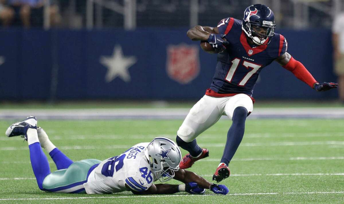 Houston Texans wide receiver Uzoma Nwachukwu (17) runs past Dallas Cowboys linebacker Donnie Baggs (46) during the fourth quarter of an NFL pre-season football game at AT&T Stadium on Thursday, Sept. 3, 2015, in Arlington.