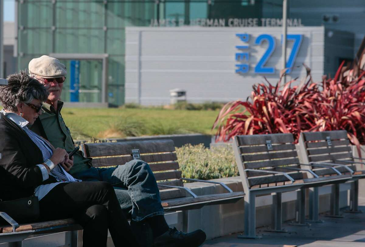From left, Eileen Arnolds and Dave Arnolds from Denver enjoy the view of the bay from Pier 27 early in the afternoon on Thursday, Sept. 3, 2015 in San Francisco, Calif.