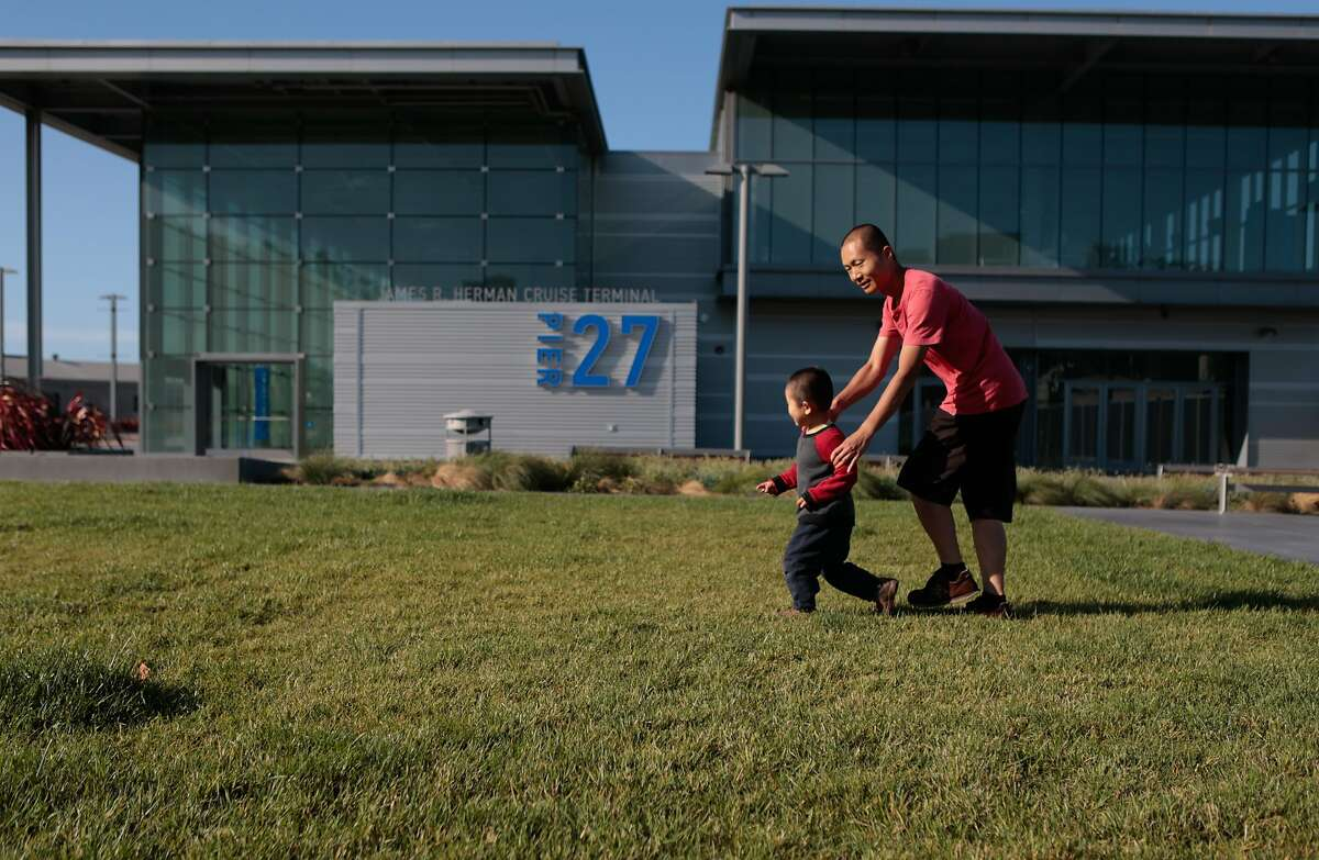 From left, John Lu, 3-years old and his father Wei Lu enjoy the open space in front of Pier 27 early in the afternoon on Thursday, Sept. 3, 2015 in San Francisco, Calif.